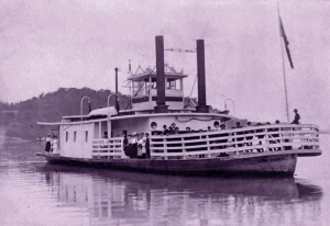 Passengers line the bow of the Nina Paden as it ferries across the Ohio River near Parkersburg, West Virginia.