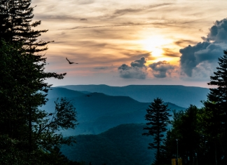 The sun sets over the Allegheny Mountains as seen from Snowshoe Mountain.