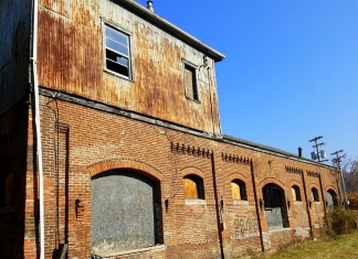 This historic freight station in Grafton is among city properties slated for rehabilitation.