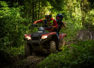 ATV riders navigate a muddy trail in the mountains of southern West Virginia.
