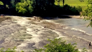 Waders explore the upper falls of the Coal River in July when the water is low in midsummer.