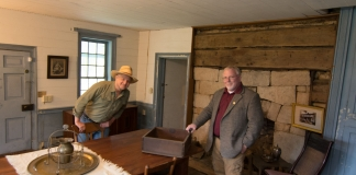 Sibray (left) and Burdette explore stonework and hewn timbers in one of the tavern rooms.