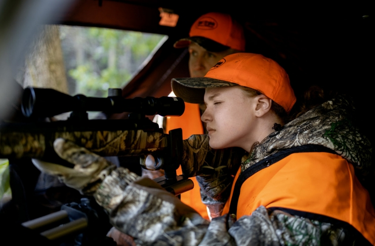 A young hunter aims from behind a blind in West Virginia.