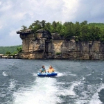 Lilly Bias and a friend ride an innertube on Summersville Lake in south-central West Virginia.