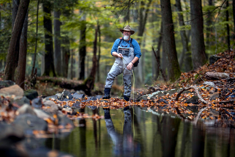 An angler casts into a West Virginia trout stream.