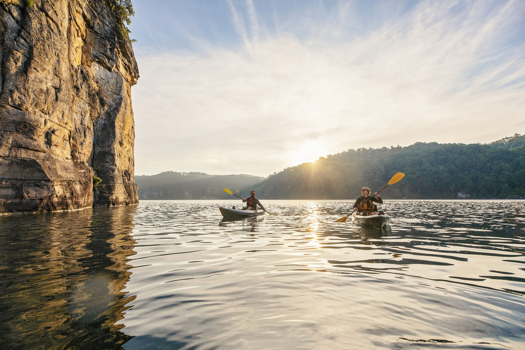 Kayakers explore the cliffs along Summersville Lake near the New River Gorge.