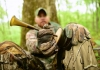 A hunter in West Virginia uses a turkey call to attract a spring gobbler.