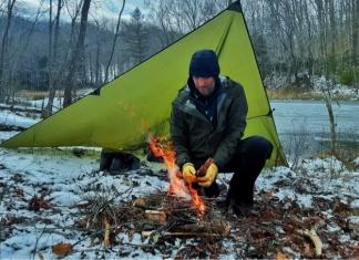 Instructor Josh Sapio tends a fire lighted from flint.