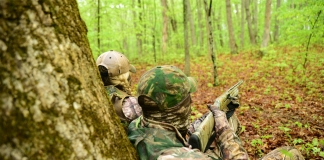 Two hunters await the opportunity to take a West Virginia spring gobbler.