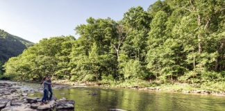 Park guests fish the Bluestone River at Pipestem Resort State Park