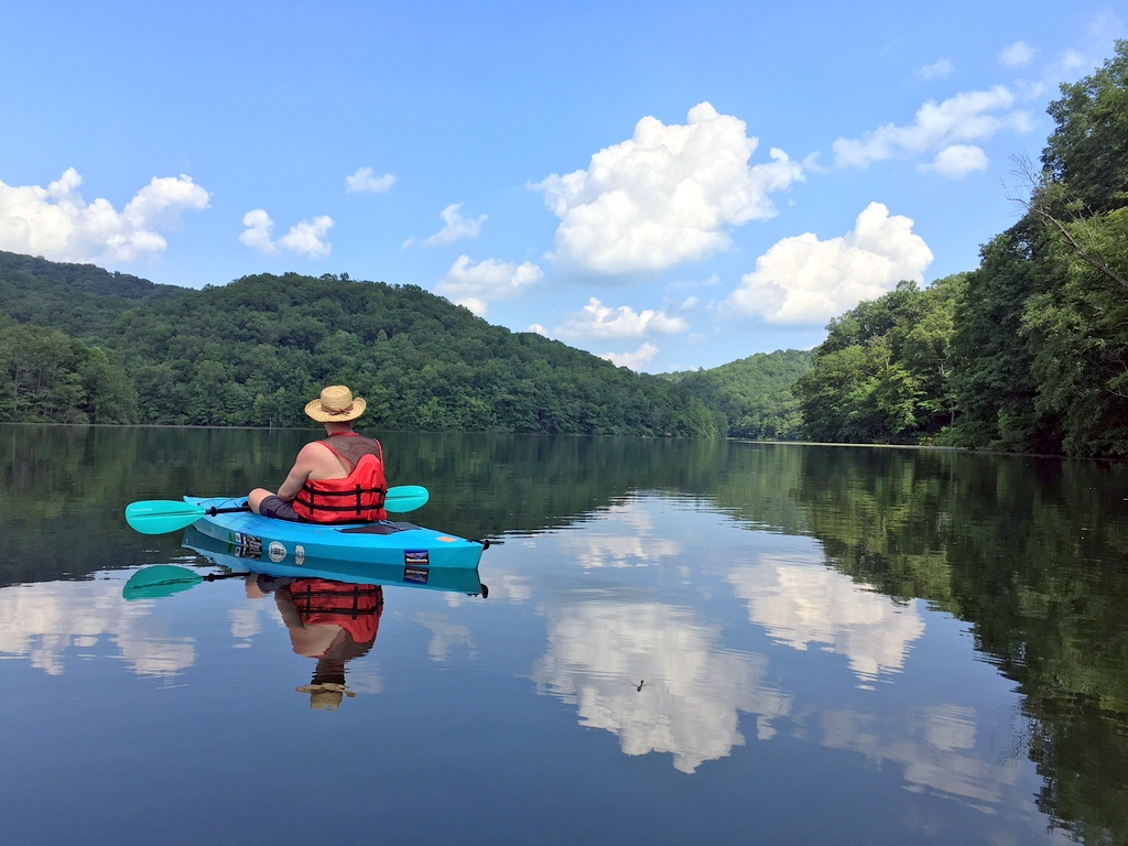 Kayakers glide across the lake at Plum Orchard Lake Wildlife Management Area.