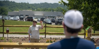 Rachel Rosenberg, a partner biologist with W.Va. Division of Natural Resources and Natural Resources Conservation Service, demonstrates planting techniques.