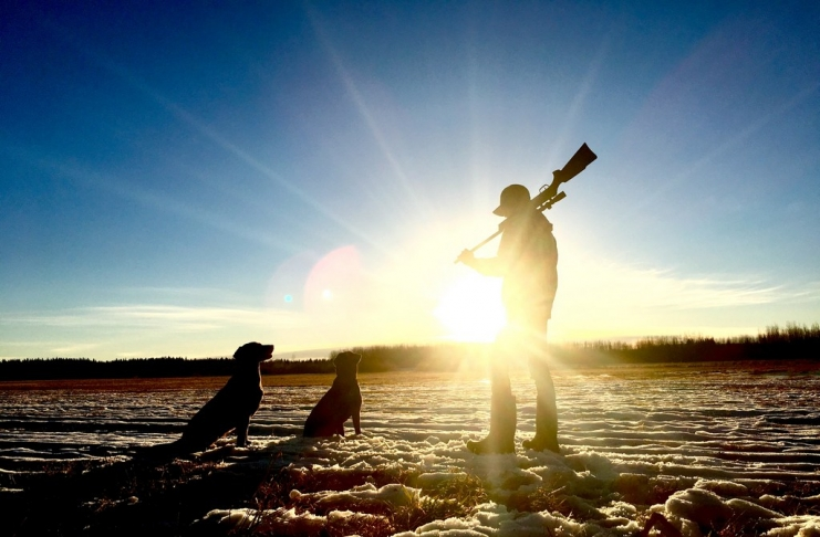 A hunter addresses his dogs during an autumn hunt. (Photo courtesy Seth Schulte)