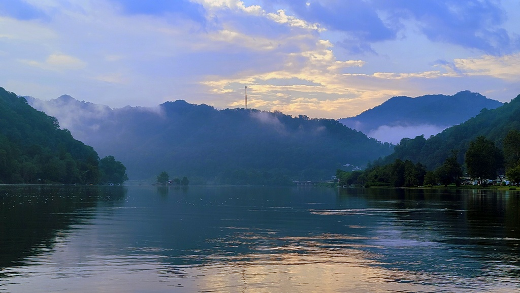 Conley Hill rises beyond the mouth of the New River at Gauley Bridge, West Virginia.